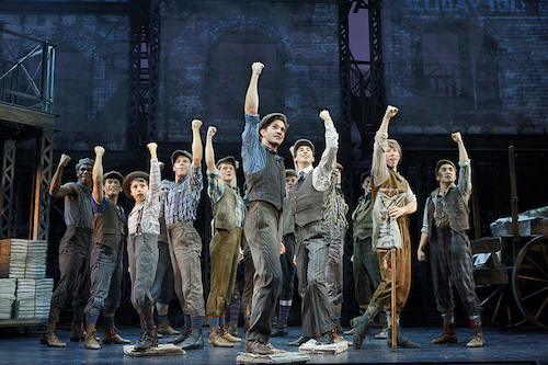 Photo of Dan DeLuca (center) and the original North American Tour company of NEWSIES by Deen van Meer.