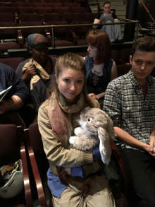 Photo of actor Cora Matheson holding a toy rabbit