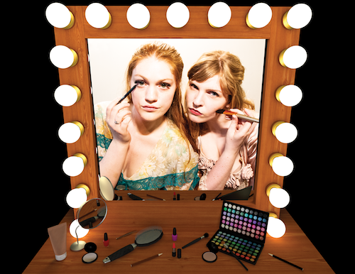 photo of Laura Mannion and Jennifer Fahy in The Ashes of Forgotten Rain - two women framed in a backstage-style lighted mirror apply makeup at a cluttered table.