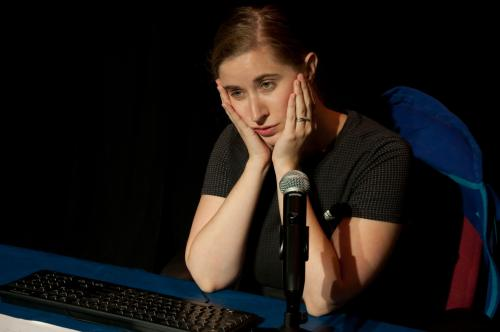 photo of woman sitting in front of keyboard and microphone