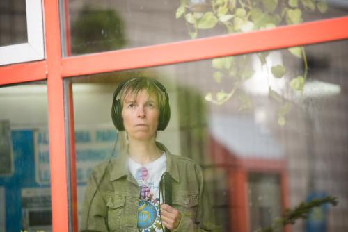 photo of Alex Bulmer, director of Scadding, looking out the window