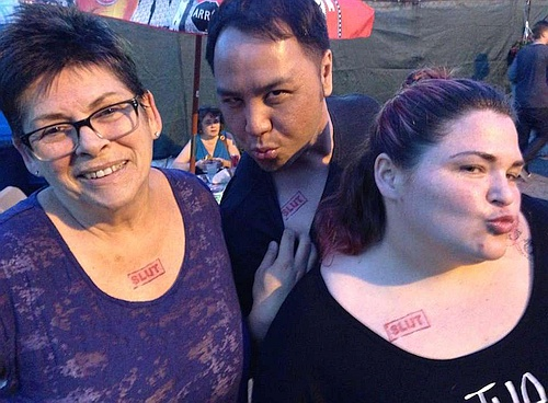 Photo of Sam Mooney, Wayne Leung and Megan Mooney with 'slut' tattoos by Erin Norah