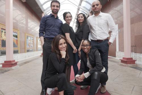 Photo of Rob Michaels, Neha Kohli, Carolyne Das, Zohaib Khan and Sima Sepehri and Nkasi Ogbonnah by a self-timer for Woke n Broke
