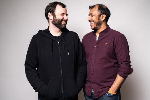 Photo of Nicolas Billon and Ravi Jain looking at each other and laughing