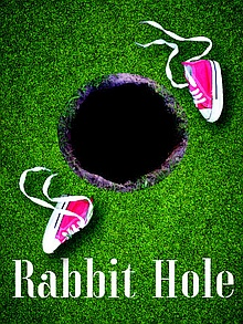 Poster image from Rabbit Hole - hold in the grown surrounded by green grass with a pair of discarded pink running shoes