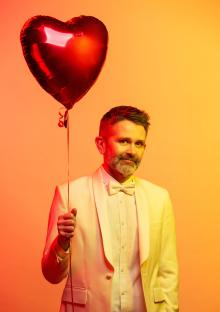 Image of Brian Francis holding a balloon in Box 4901