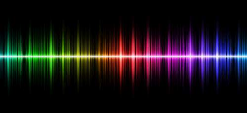 image of a rainbow coloured soundwave on a black background